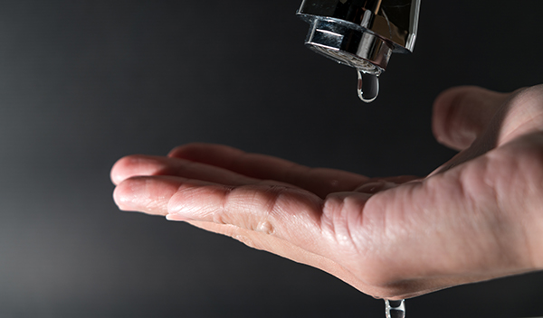 Water drops from a tap